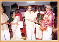 Felicitation to Padmasree Peruvanam Kuttan Marar by Cochin Dewaswom Board. Memento is presented by the Hon. President Sri. MCS Menon. From left to right:M.Sukumaran (Special Dewaswom Commissioner), M.L Vanajakshi (Member, Cochin Dewaswom Board), MCS Menon (President, Cochin Dewaswom Board), K. Kuttappan (Member, Cochin Dewaswom Board), P. Ramani (Secretary, Cochin Dewaswom Board).